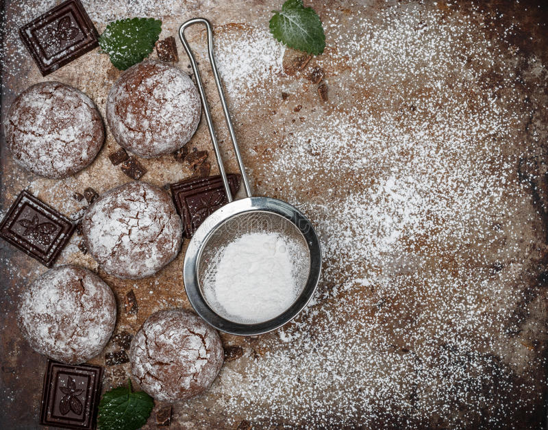Chocolate Crinkles. Cooking cookies with powdered sugar. Copy space. Chocolate Crinkles. Cooking cookies with powdered sugar. Selective focus. Copy space royalty free stock photography