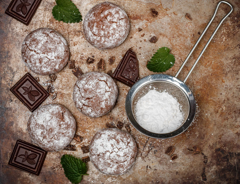 Chocolate Crinkles. Cooking cookies with powdered sugar. Copy space. Chocolate Crinkles. Cooking cookies with powdered sugar. Selective focus. Copy space royalty free stock photos