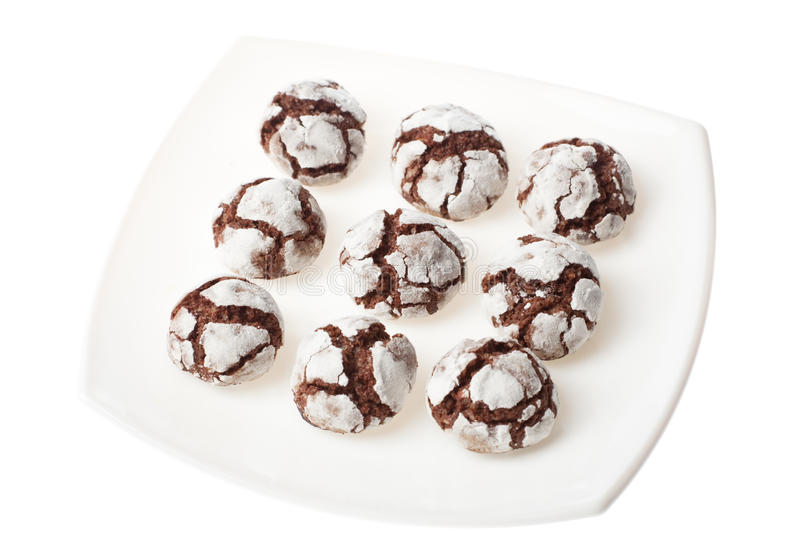 Chocolate crinkles on a plate. Chocolate crinkles on a white plate, isolated stock photography