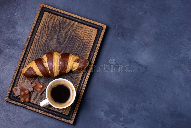 Chocolate croissant, coffee and chocolatier. Top view with copy space for text stock images