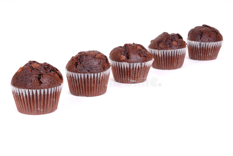 Chocolate cup cakes 5. Photograph of chocolate cup cakes isolated against white royalty free stock photography