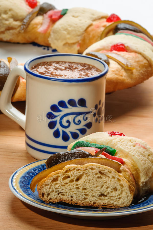Chocolate cup with Rosca de reyes, Epiphany cake, Kings cake, Roscon de reyes royalty free stock photography