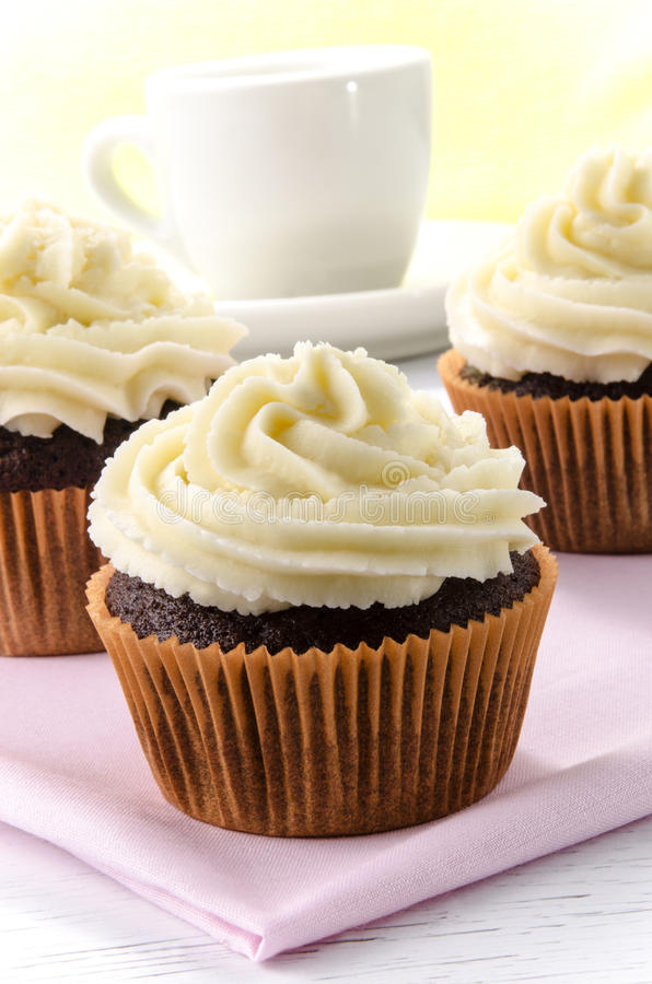 Chocolate cupcake with lemon buttercream royalty free stock photos