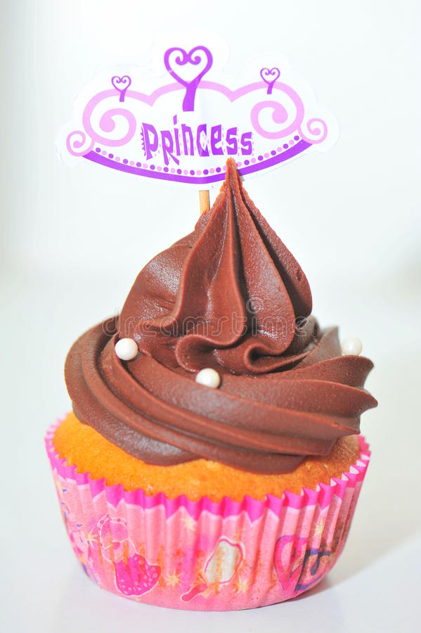 Chocolate cupcake with princess decoration. Chocolate cupcake for little pricesses royalty free stock photos