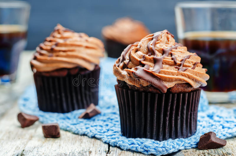 Chocolate cupcakes with chocolate cream cheese frosting royalty free stock photos