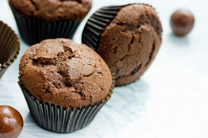 Chocolate cupcakes, delicious homemade chocolate cakes. With cracks in brown paper cases royalty free stock photography
