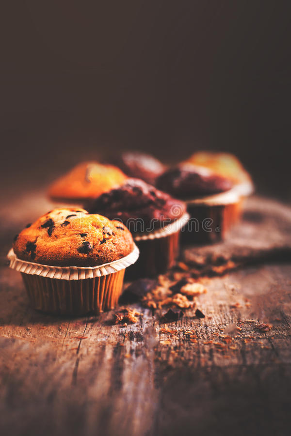 Chocolate dark muffins on wooden table close up with copy space royalty free stock photography