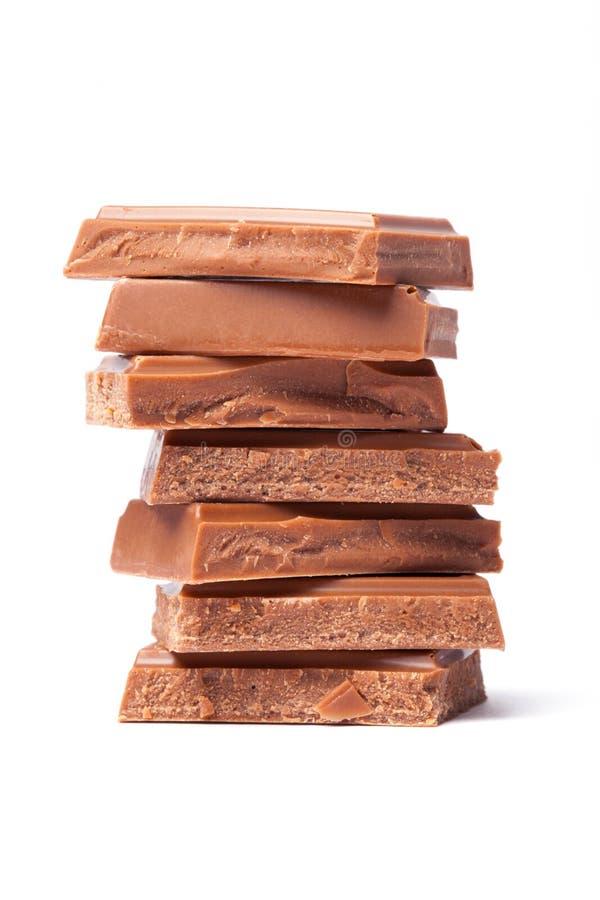Chocolate de leite das partes fotografia de stock