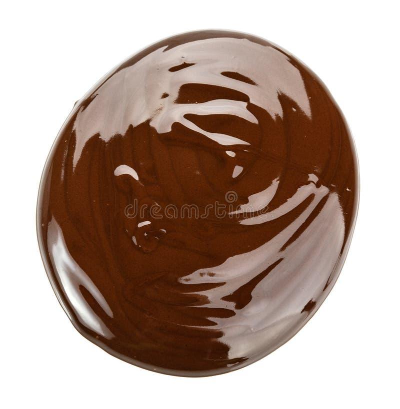 Chocolate derretido Aislado en el fondo blanco con la palmadita del recortes foto de archivo libre de regalías