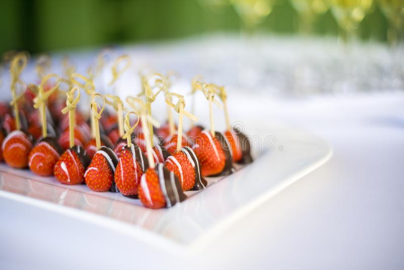 Chocolate dipped strawberries on a plate at a wedding table stock photography