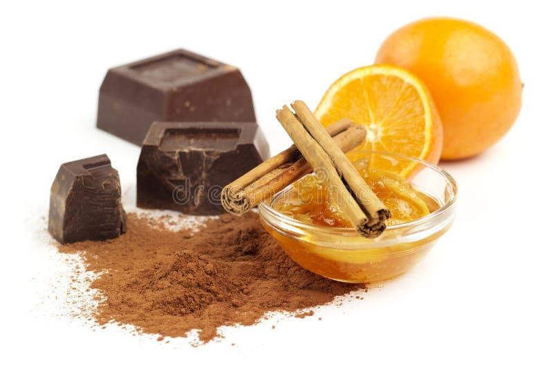 Chocolate, doce de fruta e canela imagens de stock