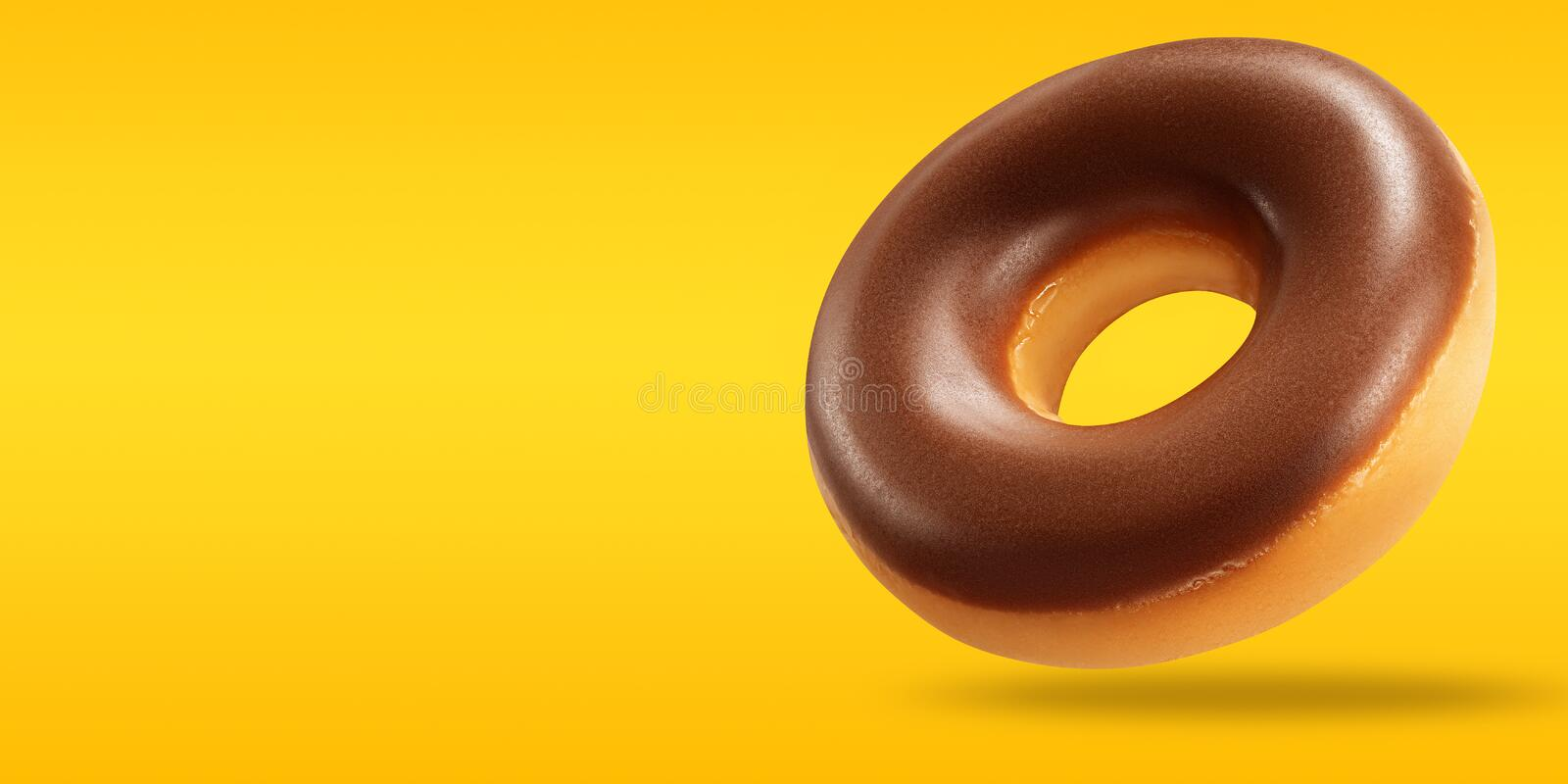 Chocolate donut in flying with copy space on yellow and orange background. Creative layout with doughnut chocolate. Summer concept stock photo