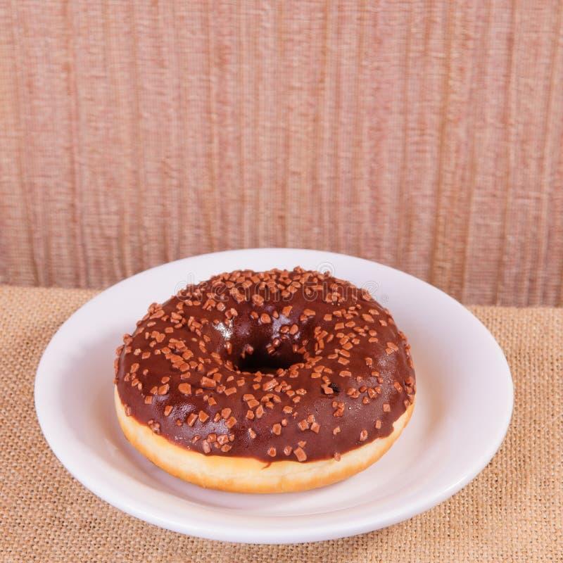 Chocolate donut on plate stock photo