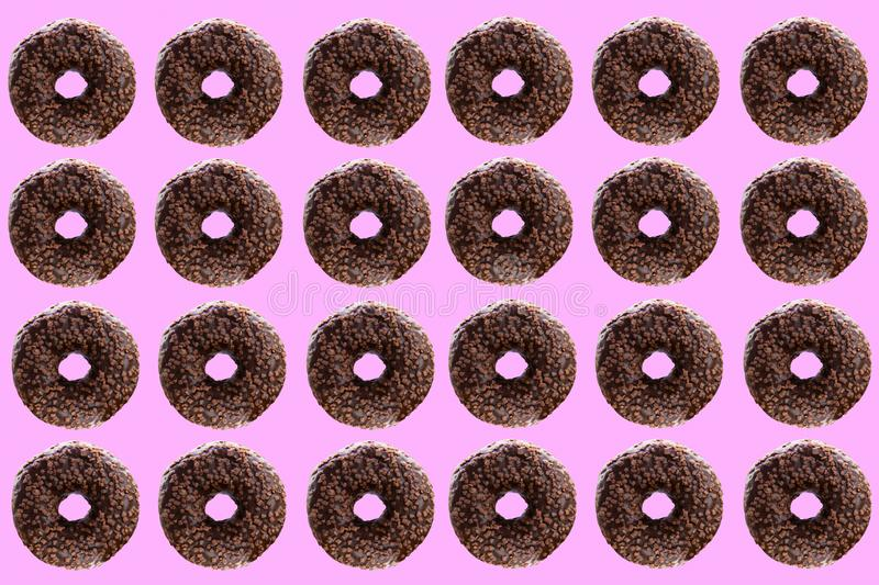 Chocolate donuts on a pink background. stock photos