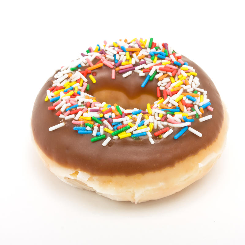 Chocolate Doughnut. With vibrant multicoloured sprinkles isolated against white stock photos