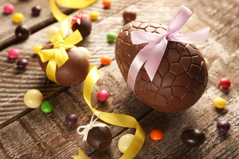 Chocolate Easter eggs with color ribbon bows royalty free stock photos