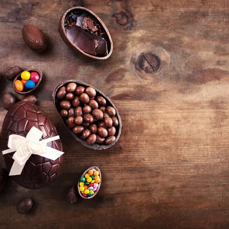 Free Chocolate Easter Eggs On Wooden Background With Ribbon Bow And C Stock Photos - 112095513