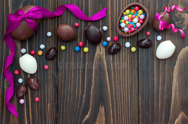 Chocolate Easter eggs over rustic wooden background. Copy space. Chocolate Easter eggs over rustic wooden background. Copy space royalty free stock image