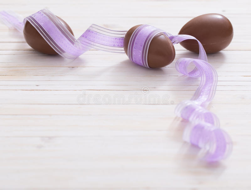 Chocolate Easter Eggs. Over Wooden Background royalty free stock image