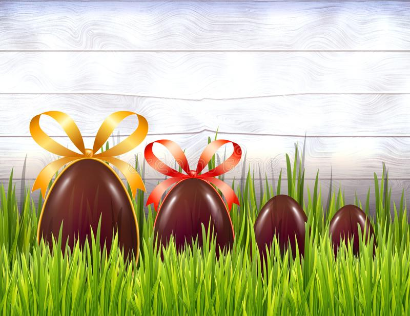 Chocolate Easter eggs with ribbon bows on white rustic wooden background with grass. Copy space.  stock illustration