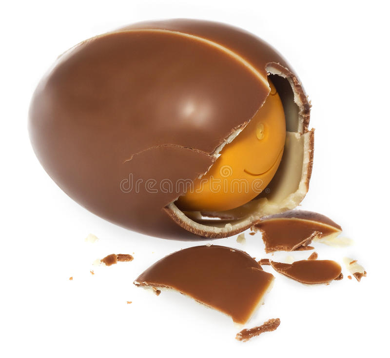 Free Chocolate Egg Surprise. Gift Egg Broken On The Side, Pieces Of Crushed Chocolate. Stock Photos - 86221053