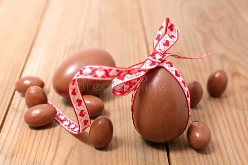 Chocolate egg. On wood background royalty free stock images