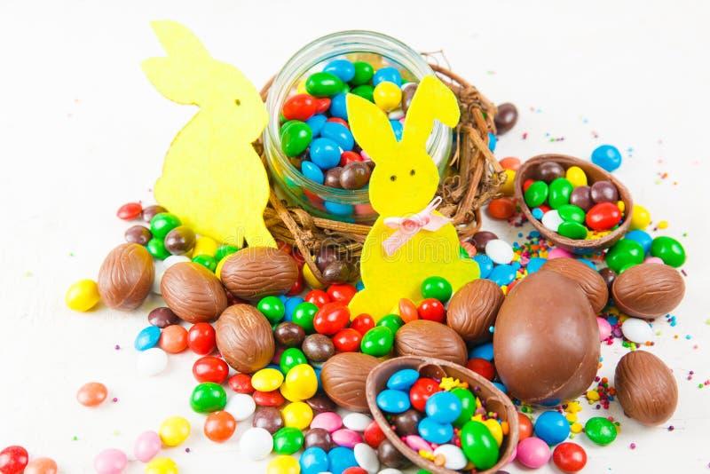 Chocolate eggs and color candy glaze stock photos