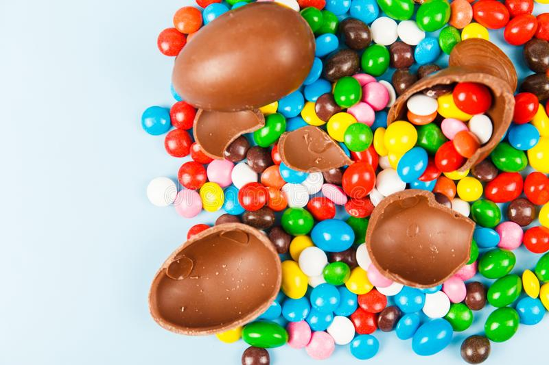 Chocolate eggs and color candy glaze stock image