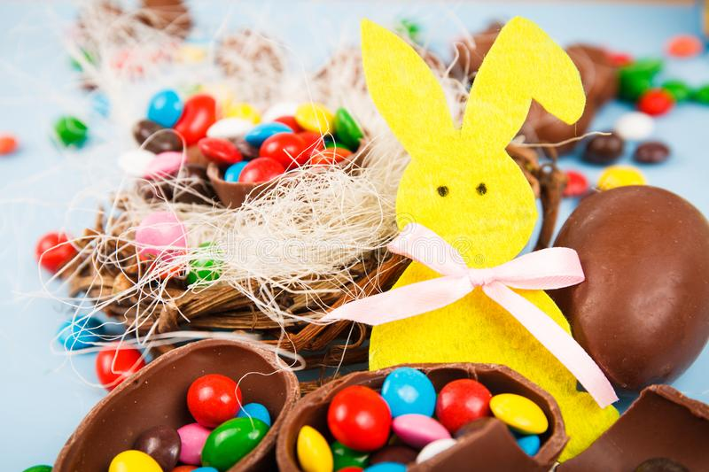 Chocolate eggs and color candy glaze royalty free stock image