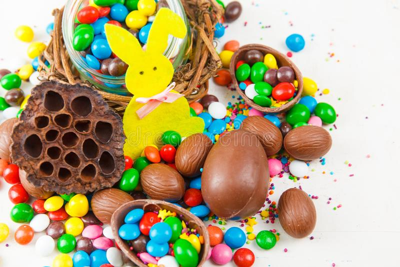 Chocolate eggs and color candy glaze royalty free stock photos