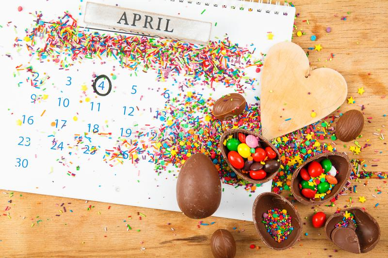 Chocolate eggs and color candy glaze royalty free stock images