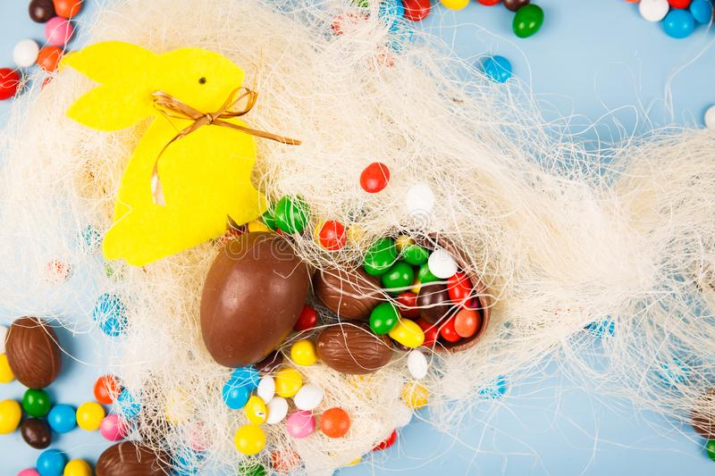 Chocolate eggs and color candy glaze royalty free stock photography