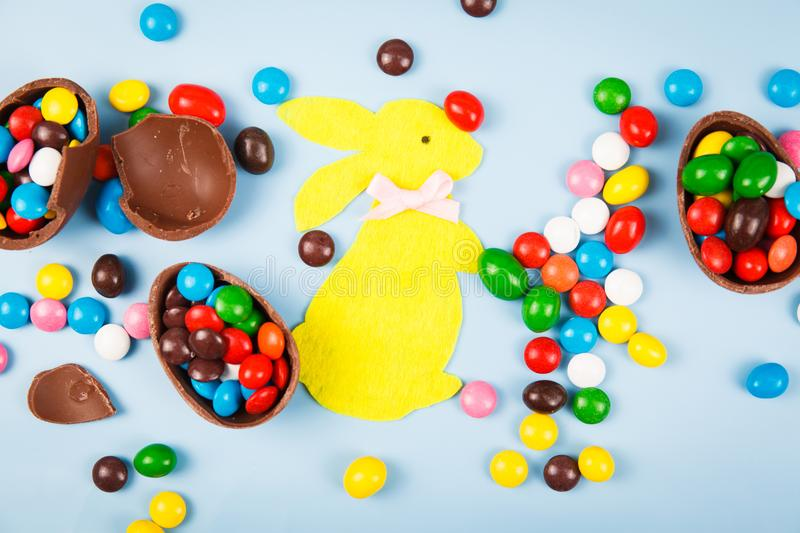 Chocolate eggs and color candy glaze stock photo