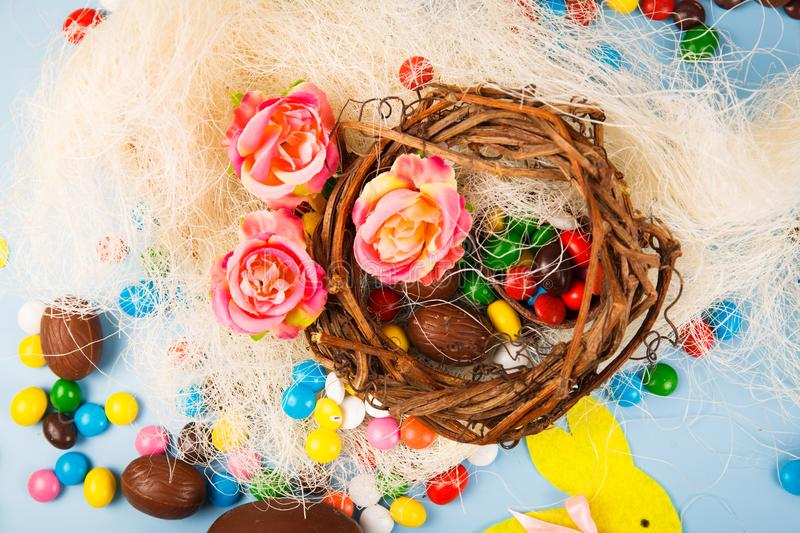 Chocolate eggs and color candy glaze royalty free stock photo