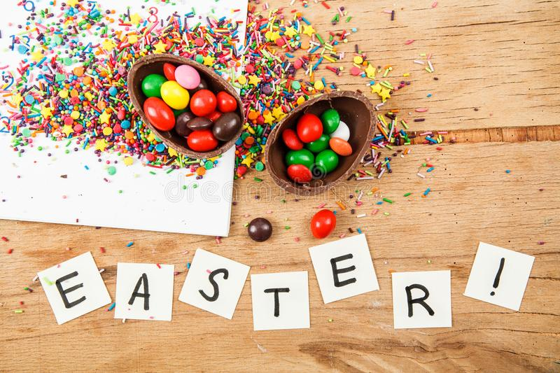 Chocolate eggs and color candy glaze stock images