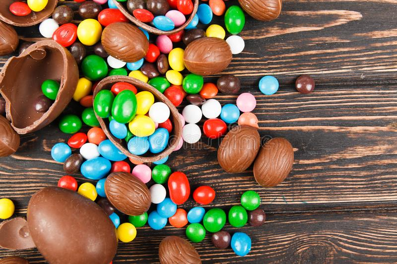 Chocolate eggs and color candy glaze stock photography