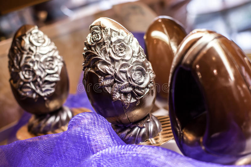 Chocolate eggs. With decorations and sculptures stock photo