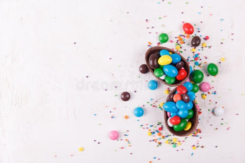 Chocolate eggs and glaze color candy stock photos
