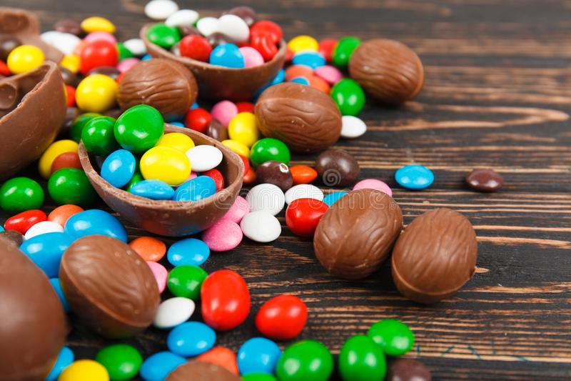 Chocolate eggs and glaze color candy royalty free stock image