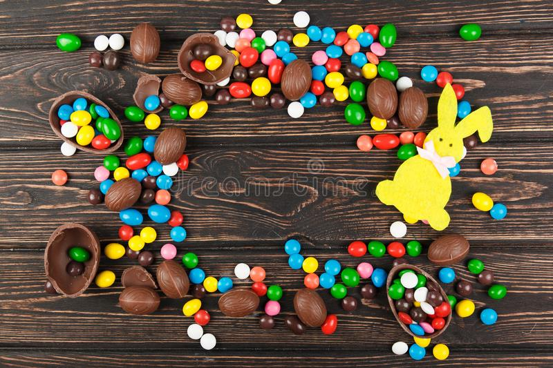 Chocolate eggs and glaze color candy royalty free stock photography