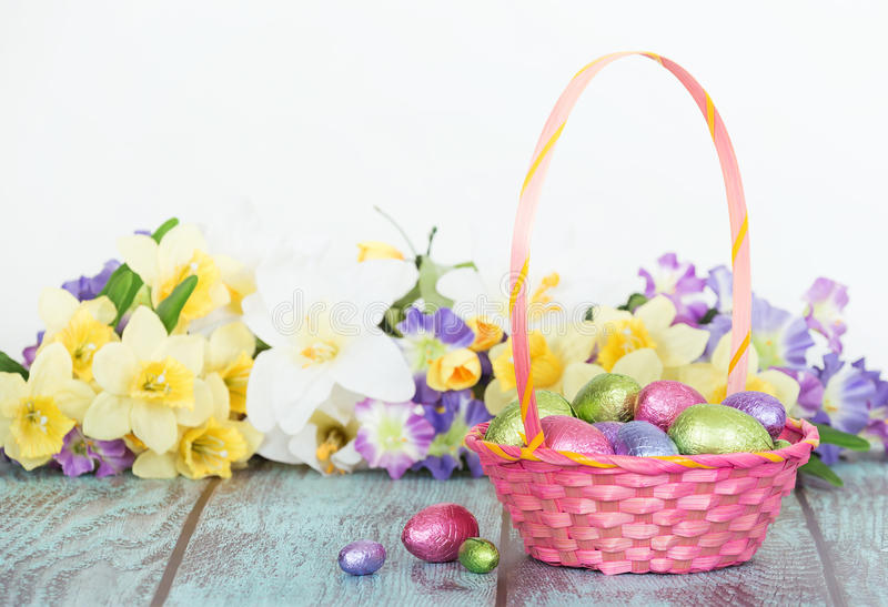 Chocolate eggs in a pink Easter basket stock images