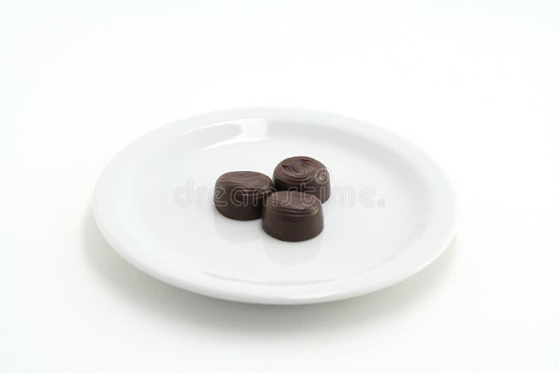 Chocolate em uma placa fotos de stock