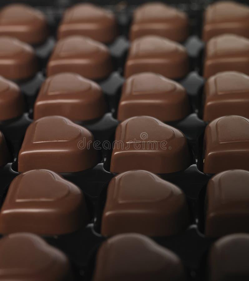 Chocolate en forma de corazón fotos de archivo
