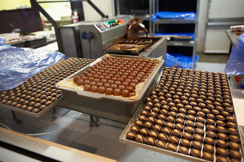 Chocolate factory. Various of chocholate couvuture at chocolate factory stock image