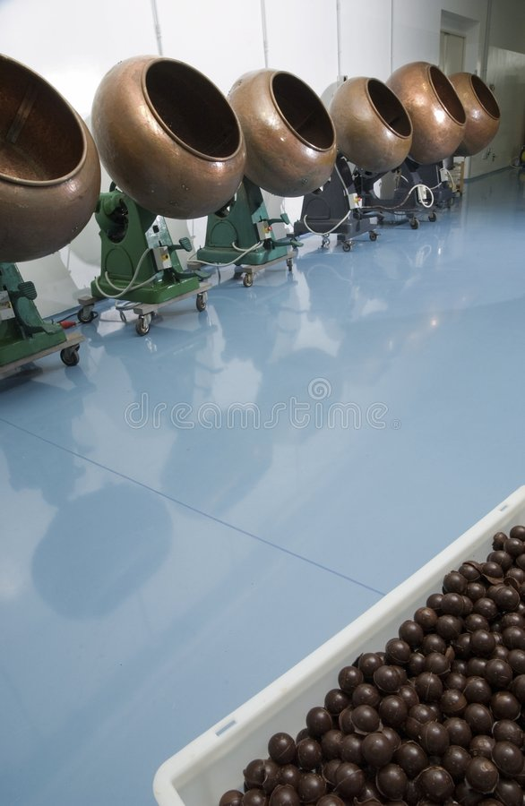 Chocolate factory interior. With equipment in perspective stock photography