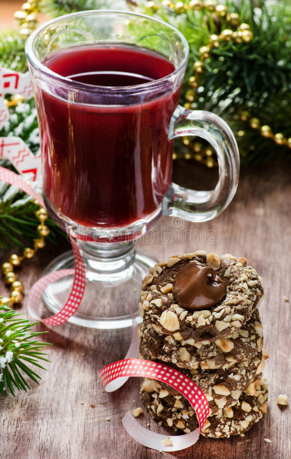 Chocolate filled cookies and juice with festive decorations royalty free stock photo