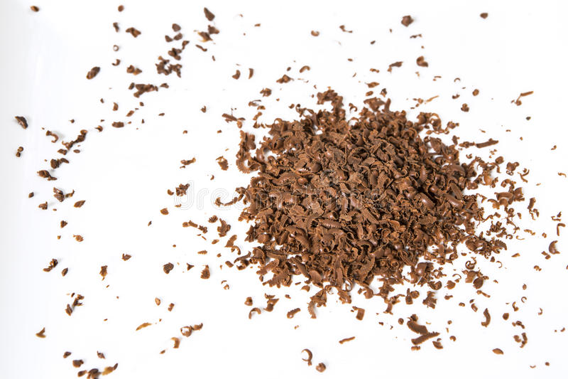 Chocolate flakes. On white background royalty free stock photography