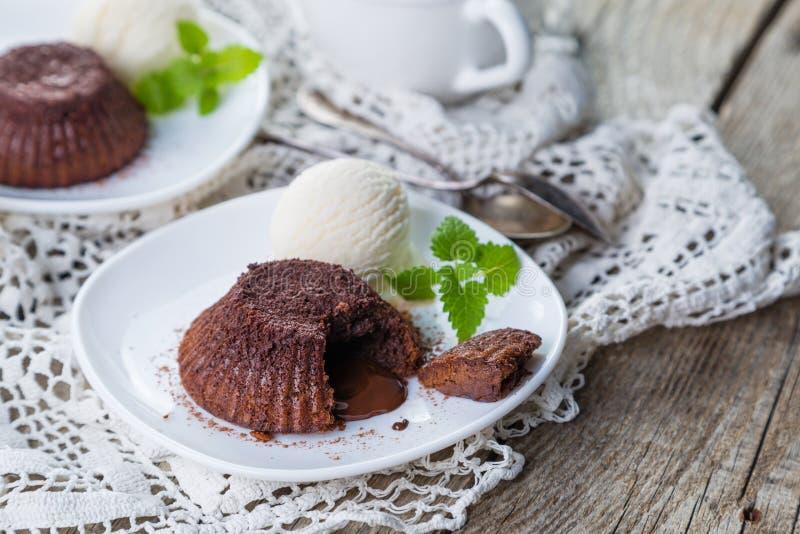Chocolate fondant - lava cake with vanilla ice cream. Copy space stock photography