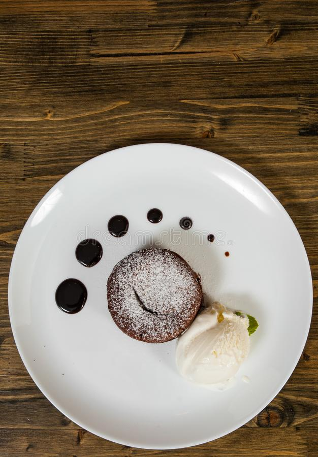 Chocolate fondant on a wooden background. with copy space. stock images