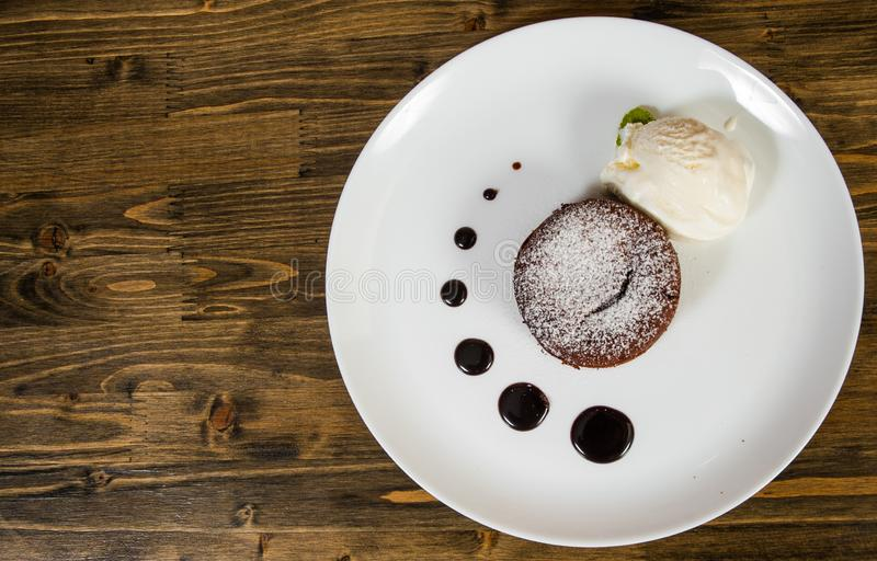 Chocolate fondant on a wooden background. with copy space. stock photography